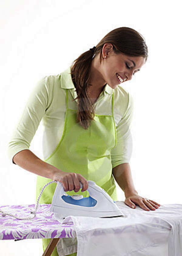 happy-woman-doing-ironing-17218536