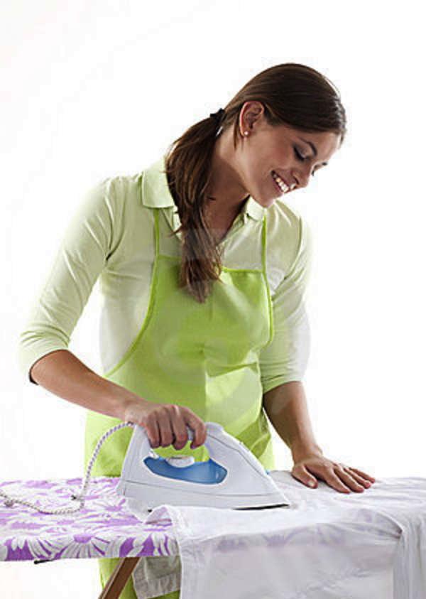 happy-woman-doing-ironing-17218536